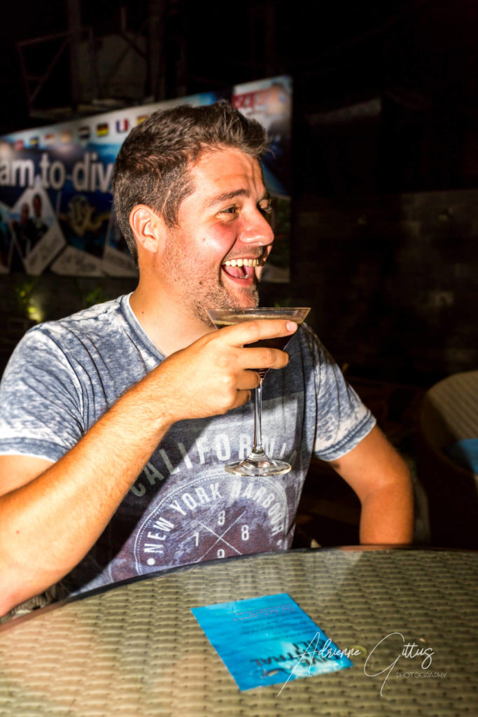 Smiling happy man with espresso martini cocktail