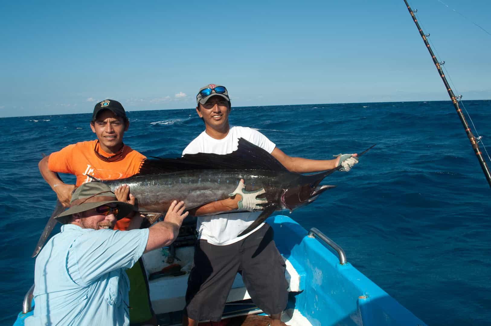 Fishermen on boat with marlin catch and release