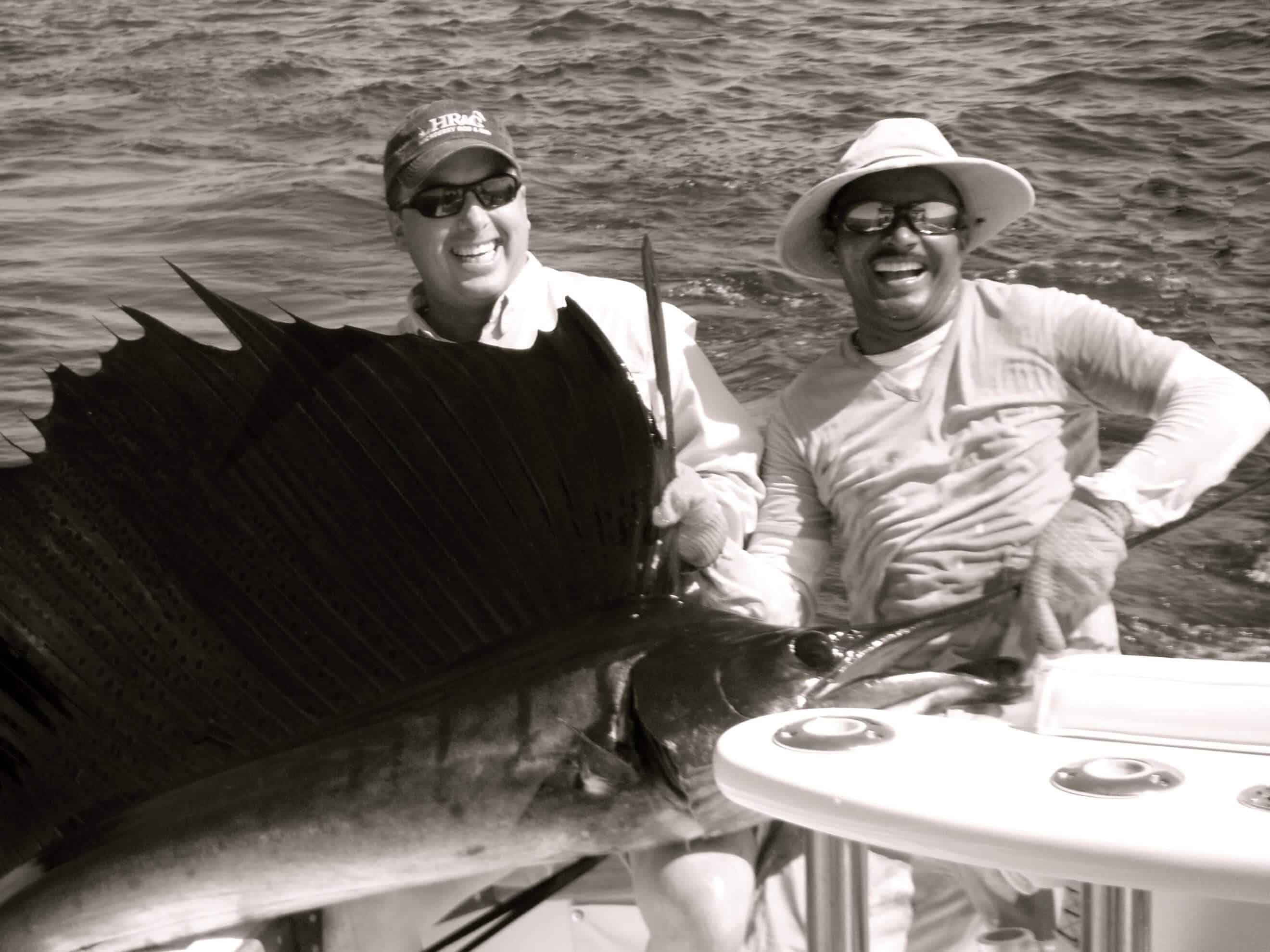 Fishermen with huge sailfish on boat catch and release