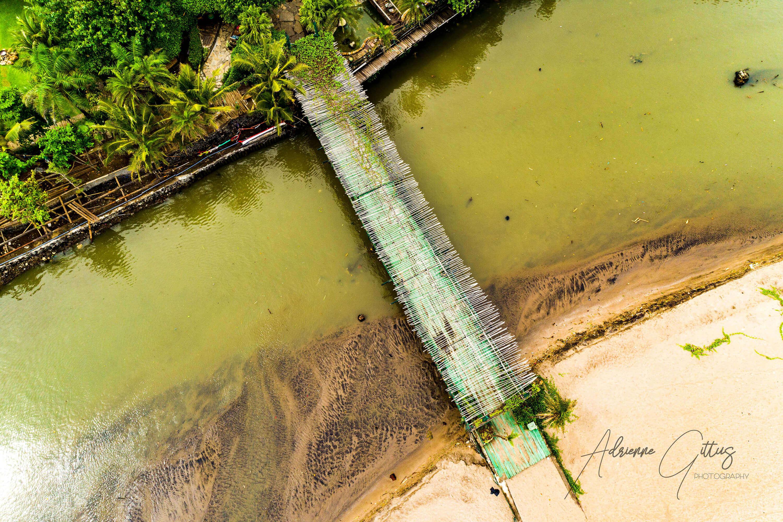 Rickety bridge ovre estuary, pantai berawa, bali