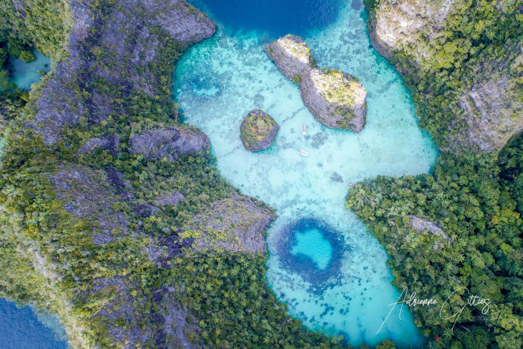 heart-shaped lagoon, drone, aerial, clear aqua blue water, Wayil, Raja Ampat, Indonesia,