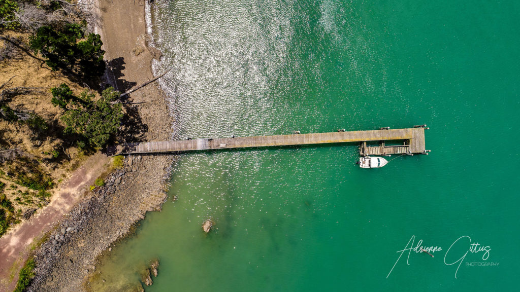 boat on a jetty, Man 'O War bay, Waiheke Island, New Zealand, summer, aerial, drone, aqua water, sea