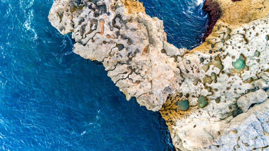 Secret place, Nusa Ceningan, Bali, Indonesia, drone, aerial, limestone rocky cliffs