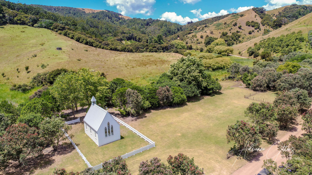 Wedding chapel, Man 'O War Bay, Waiheke Island, New Zealand, drone, aerial, summer, blue sky, green, trees, nature