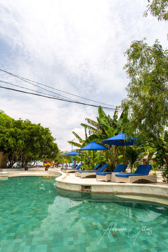 Gili Teak Pool, Indonesia, Blue sky, sun loungers