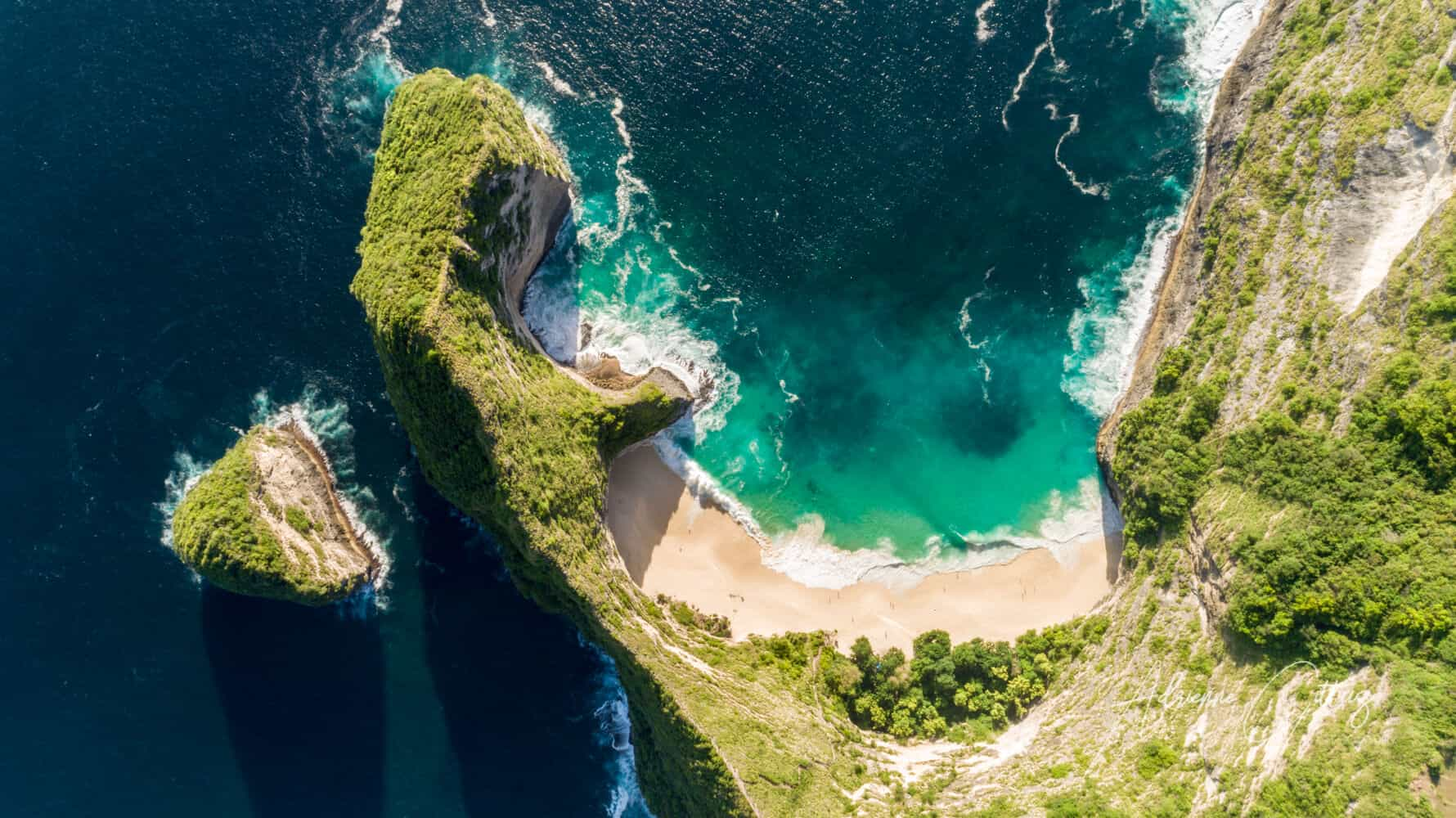 aerial drone shot looking straight down from maximum altitude at Kelingking Beach, Nusa Penida, Bali, Indonesia
