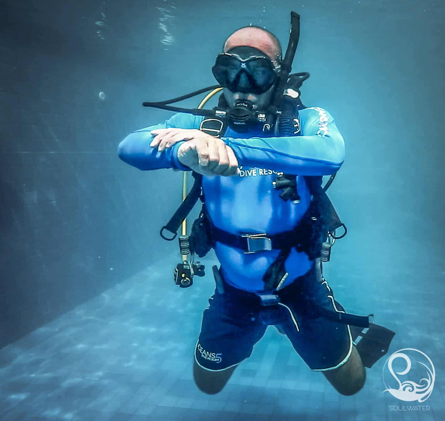 A diver practicing buoyancy skills in the pool, hovering