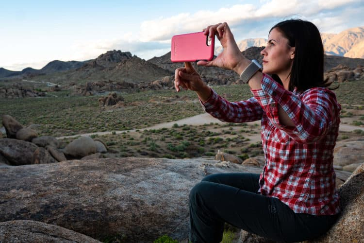 Woman taking selfie in beautiful mountain landscape